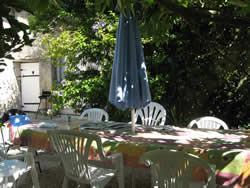 Private garden areas with outdoor dining furniture and BBQ